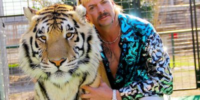 Joe Exotic and one of his many tigers that he owns at his exotic animal park.