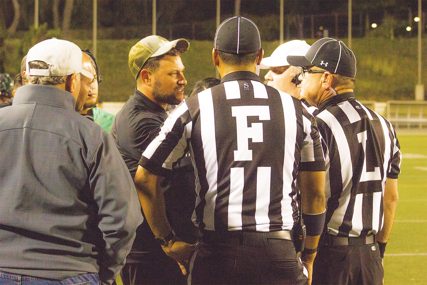 Football coach receives reduced punishment - East Los ...
